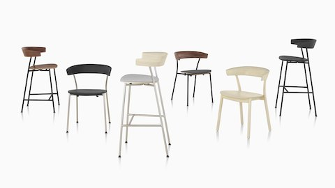 A grouping of Leeway Chairs and stools showcasing the various base materials, finishes, and upholstery options.