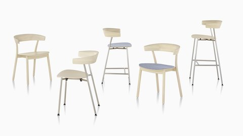A grouping of light wood Leeway Chairs and Stools, with metal or wood bases, and upholstered or upholstered seats.