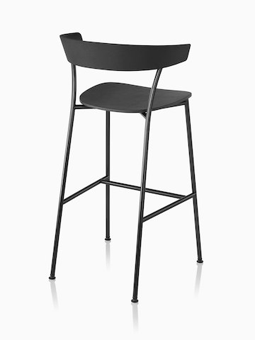 Black Leeway Stool with black metal base, viewed from behind.