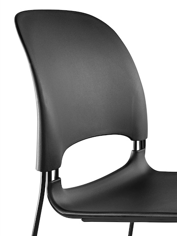 Close view of a black Limerick side chair, showing the flexible back and the ventilation opening between the back and seat.