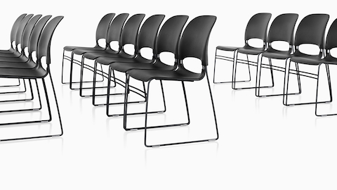 Three rows of black Limerick side chairs aligned with ganging glides.
