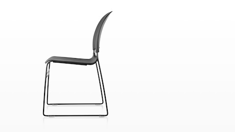 Profile view of a black Limerick side chair, showing the sled base.