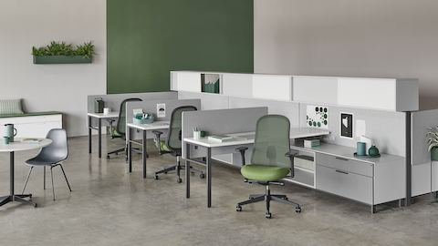 Black and green Lino Chairs with adjustable sacral lumbar support, paired with Canvas Wall workstations.