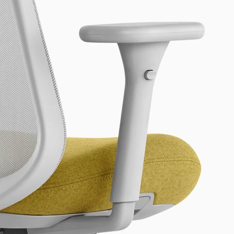 Close up image of a gray and yellow Lino Chair with adjustable sacral lumbar support and adjustable height arms, viewed from the back at an angle.