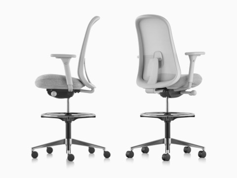 Two light gray Lino Stools with adjustable sacral lumbar support, viewed from the side and from the back at an angle.