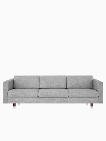 Lispenard sofa with gray fabric upholstery and walnut wooden legs.