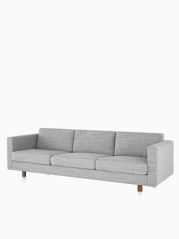 Lispenard sofa with gray fabric upholstery and walnut wooden legs. Select to go to the Lispenard Sofa Group product page.
