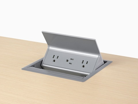 A gray, grommet-mounted Logic power port with three power outlets.