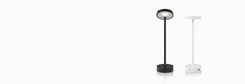 Front view of Lolly Personal Light in black with the adjustable head tilted upward. Front view of Lolly in white with the adjustable head tilted downward.
