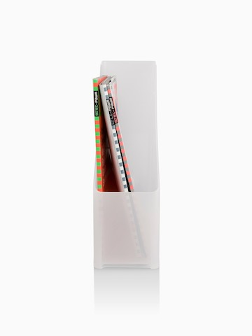 A vertical desktop holder containing reference materials.