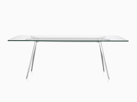 Magis Baguette Table with a clear glass top and polished cast aluminum legs in front view.
