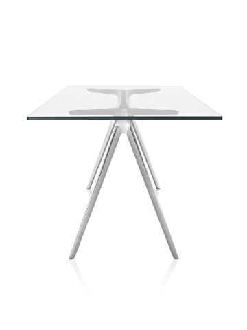 Side view of Magis Baguette Table with a clear glass top and polished cast aluminum legs.