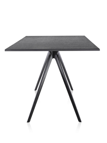 Magis Baguette Table with black stone top with black painted cast aluminum legs in side view.