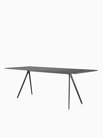 A rectangular Magis Baguette Table with a black top. Select to go to the Magis Baguette Table product page.