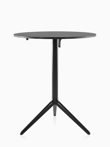 A round Magis Central occasional table with a black top and frame.