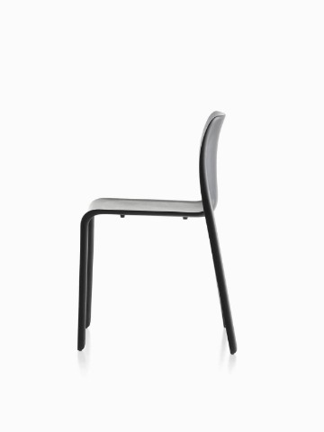 Profile view of a black Magis Chair First plastic stacking chair.