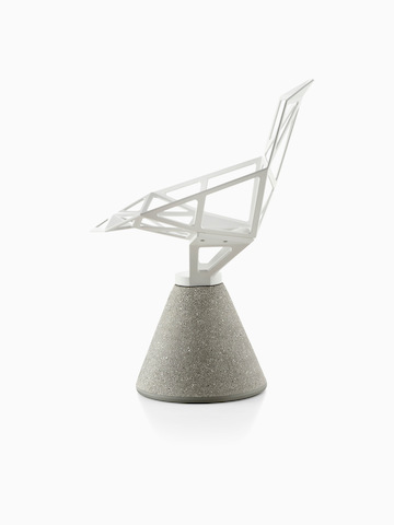 Profile view of a white Magis Chair_One side chair with a concrete base.