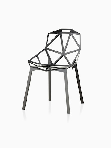 White Magis Chair_One side chair with a stackable four-leg base, viewed from a 45-degree angle.