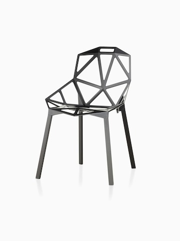 Black Magis Chair_One side chair with a stackable four-leg base, viewed from a 45-degree angle.