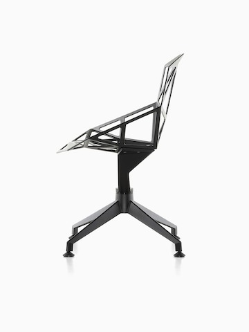 Profile view of a black Magis Chair_One side chair with a four-star base.