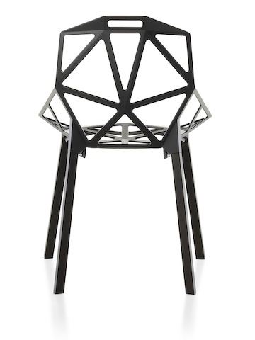 Profile view of the upper half of a white Magis Chair-One side chair.