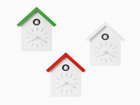 Three contemporary cuckoo clocks with green, orange, and white roofs.