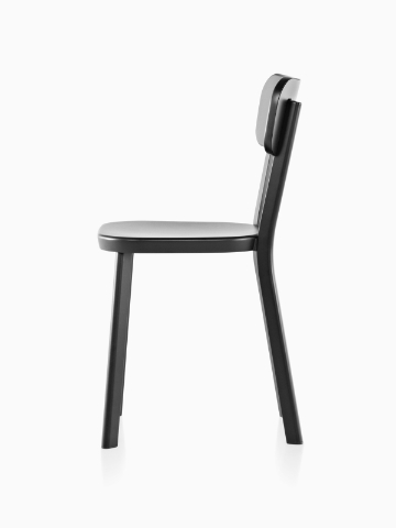 Profile view of an aluminum Magis Déjà-vu outdoor chair in a black finish.