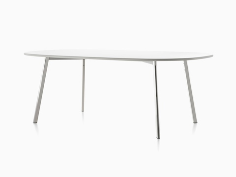 Angled view of an oval Magis Déjà-vu Table with a white top.