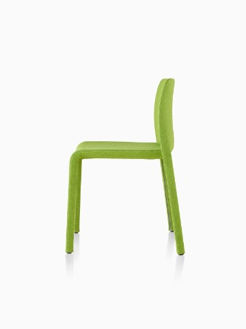 Profile view of a green Magis Dressed First side chair.