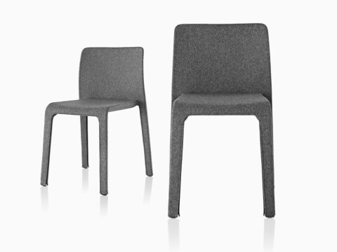Side-by-side Magis Dressed First side chairs with gray fabric.