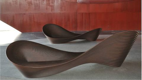 Brown Magis Folly Bench, viewed from front in an outdoor lounge.
