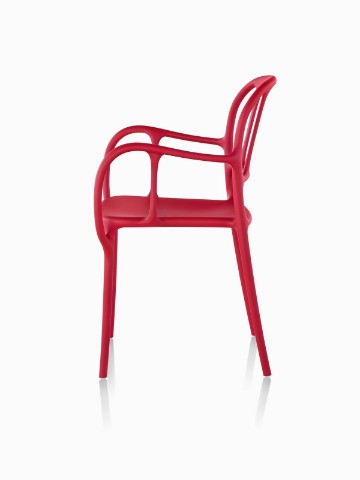 Profile view of a red Magis Milà side chair.