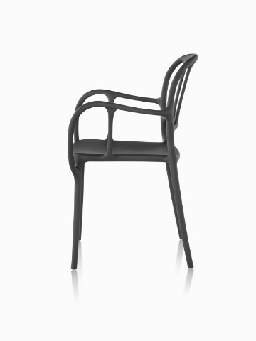Profile view of a black Magis Milà side chair.