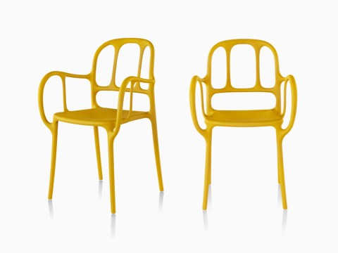 Side-by-side yellow Magis Milà side chairs, one viewed from a 45-degree angle and one viewed from the front.