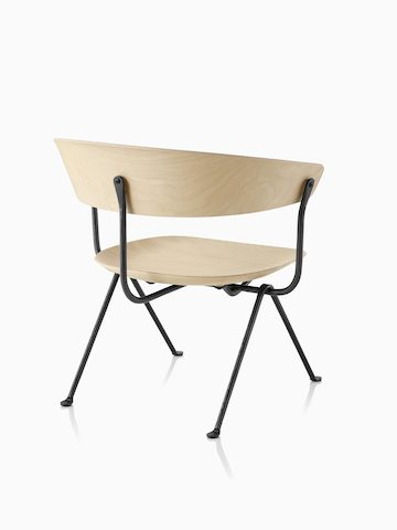 Magis Officina Low Chair in natural beech, viewed from the back at an angle.