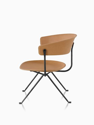 Magis Officina Low Chair in natural leather, viewed from the side.