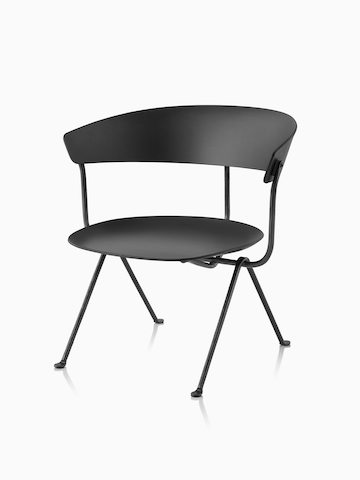 Magis Officina Low Chair in black beech with black frame, viewed from the front from an angle.
