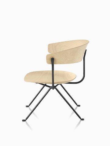 Magis Officina Low Chair in black beech with black frame, viewed from the front.