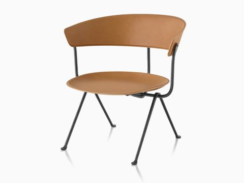 Magis Officina Low Chair in natural leather, viewed from the front at an angle.