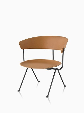 Magis Officina Low Chair in natural leather. Select to go to the Magis Officina Low Chair product page.