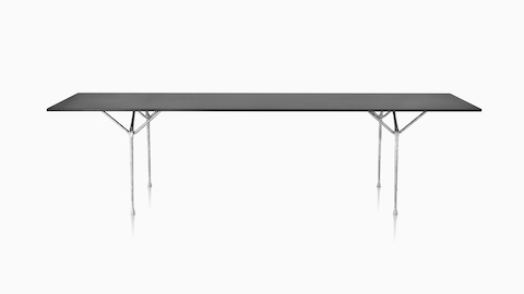 A rectangular Magis Officina Table with a black top and wrought iron legs, viewed from the long side.