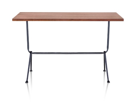 A rectangular Magis Officina Table with a medium veneer top and wrought iron legs, viewed from the long side.