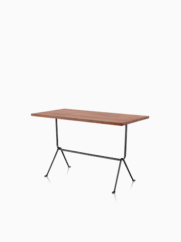 A rectangular Magis Officina Table with a medium veneer top. Select to go to the Magis Officina Tables product page.