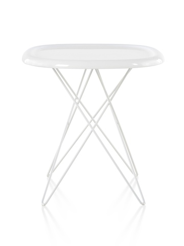 A white Magis Pizza occasional table with steel rod legs and an oblong top reminiscent of a pizza.