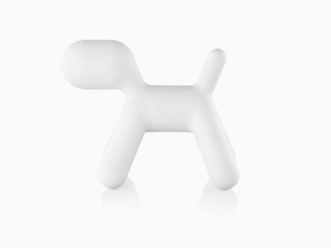Profile view of a white Magis Puppy, a sculptural plastic form shaped like an abstract dog.