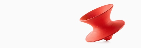 Red Magis Spun Chair, tipped at an angle and viewed from the side.