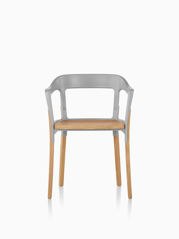 Front view of a Magis Steelwood Chair with gray metal back and light brown wood legs and seat.