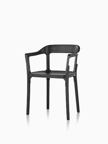 Angled view of a Magis Steelwood side chair with black metal back and black wood legs and seat.