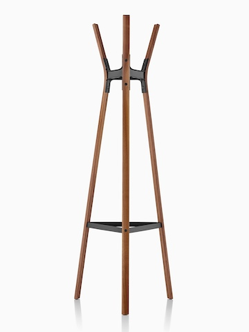 A Magis Steelwood Coat Stand with wood legs in a medium finish and black metal joinery.