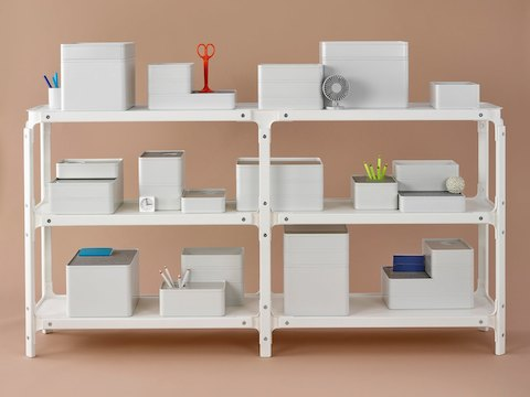 Storage containers stacked on a Magis Steelwood modular shelving system.
